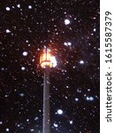Street Lamp In A Snowstorm At...