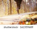 runner run in park during autumn | Shutterstock . vector #161559689