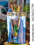 Small photo of Miami Beach, FL, USA - December 15, 2019: Shiny sterling silver English Premier Cup football/soccer trophy displayed outdoors to the Miami Beach public