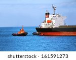 Tugboat Assisting Bulk Cargo...
