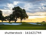 Sunset And Golf Course With Flag