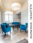Vertical view of a turquoise living room - stock photo