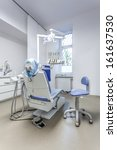 Vertical view of a seat and tools in dental office - stock photo
