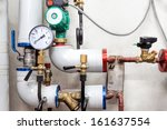 Heating pipes system with valves and counter - stock photo