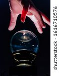 Small photo of Hand over crystal ball in dark room, crystal ball gazing, crystal ball psychic, fortune telling, scrying, object of power, seance 6