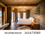 Stock photo luxury empty bedroom at home hotel wooden walls animal skin on floor lighting equipment hang on 161673080