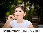 close up of woman putting pill... | Shutterstock . vector #1616737480