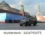 """Small photo of MOSCOW, RUSSIA - MAY 7, 2019:Armored car """"Tiger-M"""" with the combat module """"Crossbow"""" at the dress rehearsal of the parade on Red Square in honor of Victory Day"""