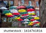 Umbrellas Covering The Street...