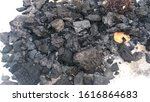 Small photo of Noisy, grainny, soft focus photo of Charcoal. It is a lightweight black carbon residue produced by removing water and other volatile constituents from animal and plant materials.