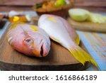 fish on wooden cutting board  ...