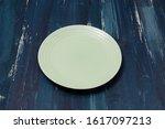 green round plate on ocean blue ...   Shutterstock . vector #1617097213