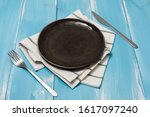 black round plate with utensils ... | Shutterstock . vector #1617097240