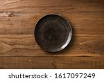 brown round plate on brown... | Shutterstock . vector #1617097249