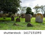 A Rural Graveyard With A...