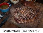 steak on rustic cutting board   Shutterstock . vector #1617221710