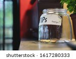 Glass Tips Jar In Cafe With Few ...