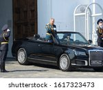 Small photo of MOSCOW, RUSSIA - MAY 7, 2019:Russian defense Minister Sergei Shoigu crosses himself at the gates of the Spasskaya tower during a dress rehearsal for the Victory day parade