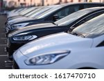 Parking car dealership  with luxury models in row - stock photo