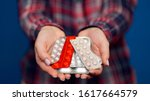 woman presenting a handful of... | Shutterstock . vector #1617664579