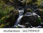 Dark Wet Rocks Have White Water ...