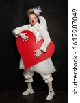 Clown Woman Posing With Red...