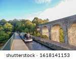 Small photo of Chirk, Wrexham, North Wales - 08.08.2018 - Canal boast crossing the Chirk aqueduct and viaduct, North Wales