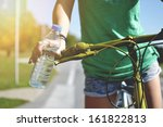 Young Woman With Bicycle ...