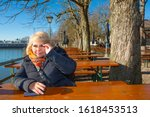 Lady Sits On A Bench Of A Tabl...