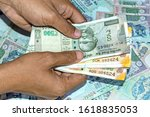 hand holds and counting new two ... | Shutterstock . vector #1618835053
