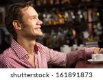 man with a cup of coffee at the ... | Shutterstock . vector #161891873