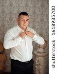 morning groom in the room.... | Shutterstock . vector #1618935700