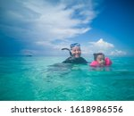 People In Snorkeling Mask Dive...
