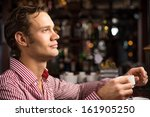 man with a cup of coffee at the ... | Shutterstock . vector #161905250