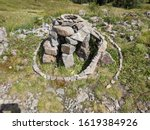 Small photo of Stones and pebbles arranged in piles and spirals along a mountain path in Bulgaria, to decorate and make clear the way.