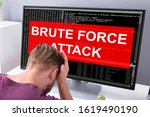 Small photo of Sider View Of An Upset Businessman Looking At Computer Screen With Brute Force Attack Message