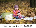 child in the autumn forest on a ... | Shutterstock . vector #161962898