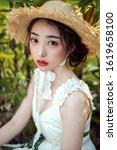 asian flowering girl in outdoor ... | Shutterstock . vector #1619658100
