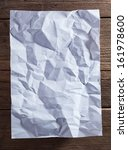 white paper on wood background | Shutterstock . vector #161978600