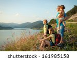 happy family watching the...   Shutterstock . vector #161985158