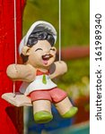 doll on swing in garden | Shutterstock . vector #161989340