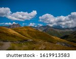 Hiking road in a Scenic mountain view under blue cloudy sky in La Fouly Switzerland