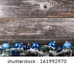 Christmas tree with baubles on wood texture - stock photo