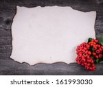 Letter for Santa on wooden background with red berries - stock photo