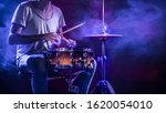 A Drummer Plays Drums On A Blue ...
