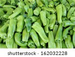 Small photo of fresh Cubanella pepper for background