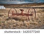 Old Rusty Plow In A Field In...