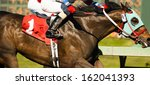 two horses and jockeys come... | Shutterstock . vector #162041393