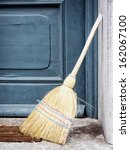 Old Broom At A Door