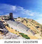 Small photo of Amphitheater or amphitheatre at ruined old Greek city at Aeolis now known as Pergamum or Pergamon in Turkey